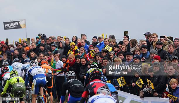 The riders make their way through the Belgian countryside during the 97th Tour of Flanders from Brugge to Oudenaarde on March 31 2013 in Oudenaarde...