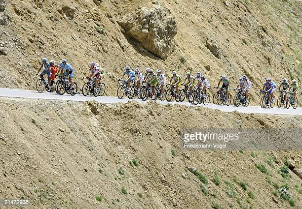 L'ALPE D'HUEZ FRANCE JULY 18 The riders make their way through the French countryside during Stage 15 of the 93rd Tour de France between Gap and...