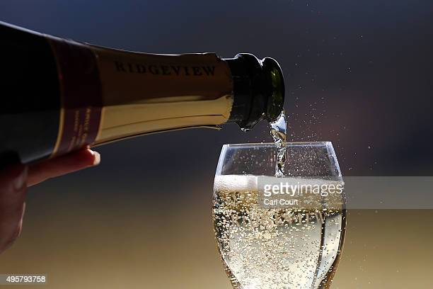The Ridgeview sparkling wine that was served to China's President Xi Jinping is poured during his state visit to the United Kingdom is poured into a...