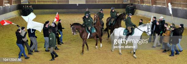 The riding team of the Bavarian police conducts an exercise in which they divide two rival groups of fans as part of a press conference in Munich...