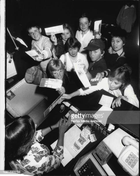 The right Australia children look in at the Qantas ticket counterFilm Director Remy Olson with left to right Ian Rowlands 12 of Melb Sean Jankins 9...