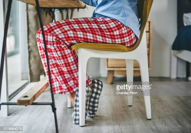 the right posture supports a productive work day - pyjamas stock pictures, royalty-free photos & images