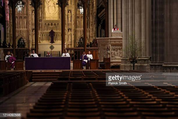 The Right Rev Bishop Mariann Edgar Budde holds Sunday Mass as it is livewebcast to its parishioners due to the Coronavirus at an empty Washington...