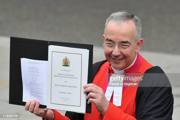 The Right Reverend Dr John Hall, Dean of Westminster shows the Order of Service to spectators prior to the Royal Wedding of Prince William to...