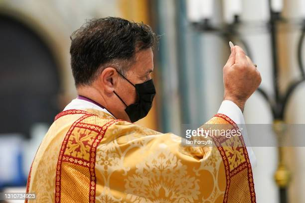 The Right Reverend Dr Jonathan Frost, Dean of York, gives Holy Communion during the Easter Sermon at York Minster at York Minster on April 04, 2021...