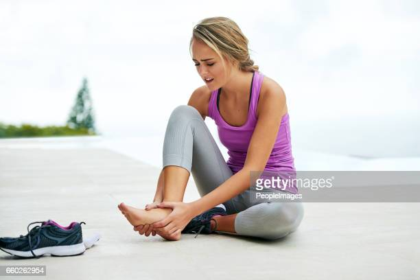 the right shoe plays a big role in your workout - pain stock pictures, royalty-free photos & images