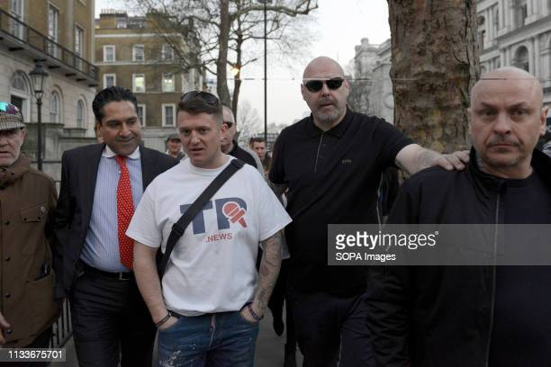 The rightwing leader Tommy Robinson whose real name is Stephen YaxleyLennon seen leaving the Make Brexit Happen stage in Whitehall after addressed a...