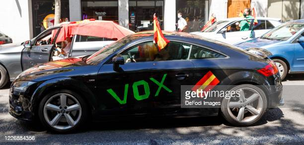The rightwing populist Vox party is calling for the resignation of the leftwing government with caravans are seen on May 23 2020 in Madrid Spain...