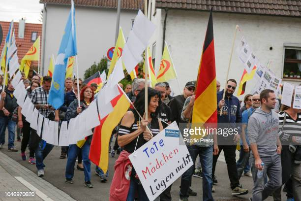 The rightwing protesters march with flags and posters through Kandel Around 300 people from rightwing organisations protested for the 14 time in the...