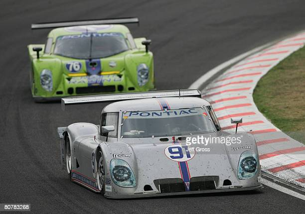 The RileyMatthews Pontiac Riley of Jim Matthews and Marc Goossens leads a car out of a turn during the Rolex Series Mexico City 250 at Autodromo...