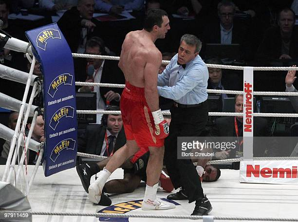 The ringreferee stops Wladimir Klitschko of Ukraine after he knocked out Eddie Chambers of USA in the twelfth round of their WBO IBF and IBO...