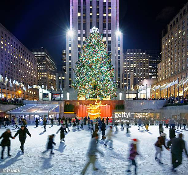the rink at rockefeller center during the holidays, new york city. - ice skating stock pictures, royalty-free photos & images