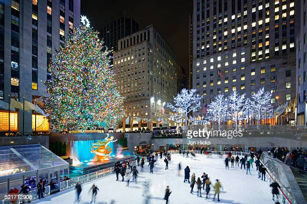 the rink at rockefeller center during the holidays, new york city. - rockefeller centre stock pictures, royalty-free photos & images