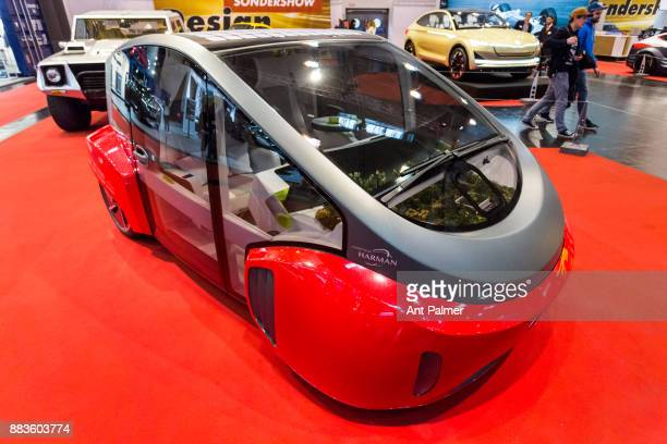 The Rinspeed a fully electric and solarpowered concept car containing its own garden is displayed at the Essen Motor Show on December 1 2017 in Essen...