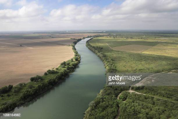 The Rio Grande flows along the USMexico border as seen from a US Air and Marine Operations helicopter patrol on November 6 2018 in McAllen Texas The...