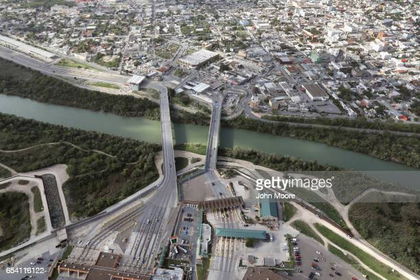 The Rio Grande flows under an international crossing between the United States and Mexico on March 16 2017 in Hidalgo Texas US Customs and Border...