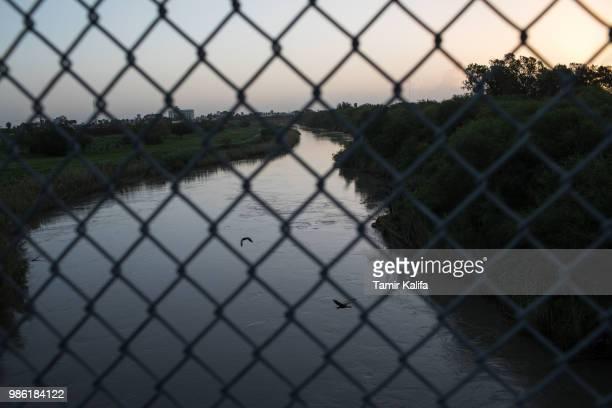 The Rio Grande flows under the Brownsville Matamoros International Bridge on June 28 2018 near Brownsville Texas Despite the Trump administration...