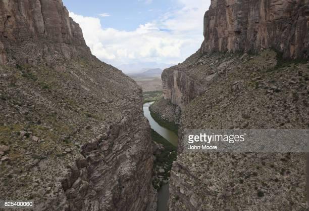 The Rio Grande forms the USMexico border while winding through the Santa Elena Pass in the Big Bend region on August 1 2017 near Lajitas Texas...