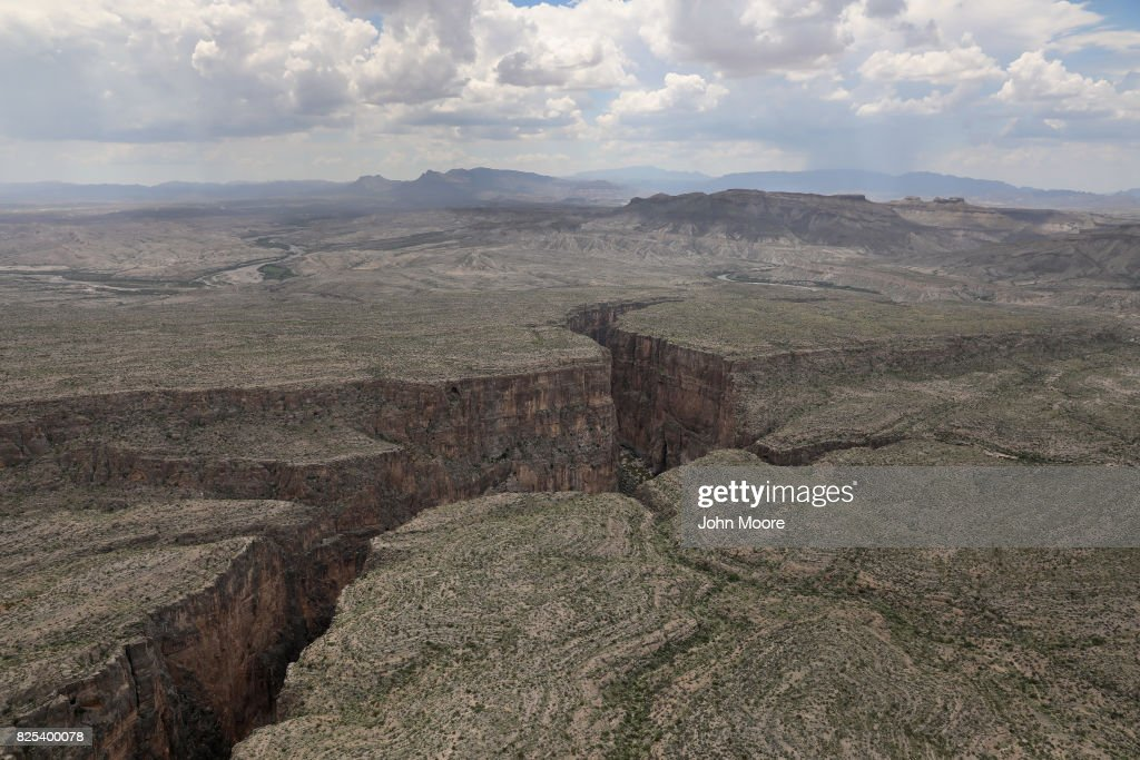 The Rio Grande forms the U.S.-Mexico border while winding through the Santa Elena Canyon in the Big Bend region on August 1, 2017 as seen from a U.S. Customs and Border Protection helicopter near Lajitas, Texas. Logistical challenges, such as the rugged terrain of Big Bend in west Texas, are just some of the complications facing the construction of a border wall proposed by President Trump.