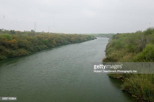 The Rio Grande River dividing Reynosa, Mexico with Hidalgo, Texas in the United States .