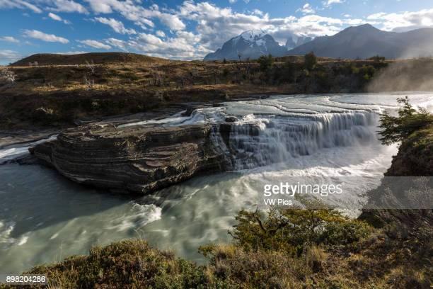 The Rio Paine Waterfalls Torres del Paine National Park Chile In the distance are Monte Almirante Nieto the three Torres del Paine and Cerro Peineta...
