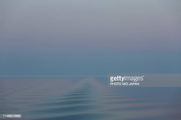 the ripples on a surface of the sea of okhotsk in the evening twilight. - horizon over water stock pictures, royalty-free photos & images