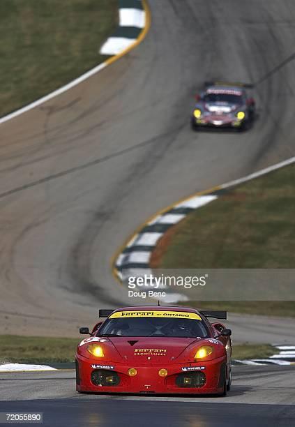 The Risi Competizione Ferrari 430 GT Berlinetta driven by Anthony Lazzaro Maurizio Mediani and Marino Franchitti makes it's way through a turn during...