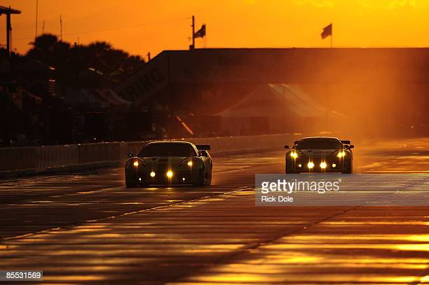 The Risi Competizione Ferrari 430 GT driven by Tracy Krohn of the United States Nic Jonsson of Sweden and Eric van de Poele of Belgium during night...