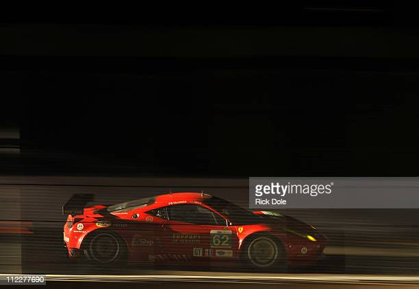 The Risi Competizione Ferrari 458 driven by Jaime Melo of Brazil and Toni Vilander of Finland competes during the Tequlia Patron American Le Mans...
