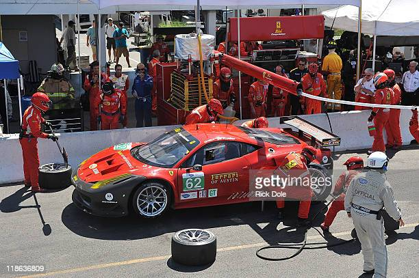 The Risi Competizione Ferrari 458 Italia driven by Jaime Melo of Brazil and Toni Vilander of Finland in for a pit stop during the American LeMans...