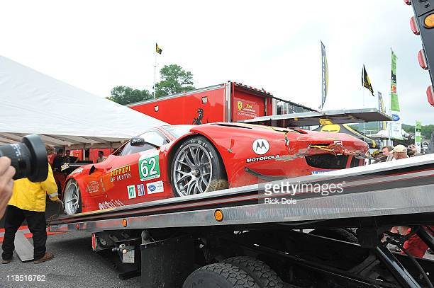 The Risi Competizione Ferrari 458 Italia driven by Jamie Melo of Brazil and Toni Vilander of Finland is returned to pit lane following an accident...