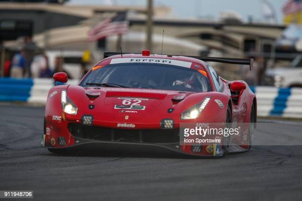 The Risi Competizione Ferrari 488 GTE of James Calado Alessandro Pier Guidi Davide Rigon and Toni Vilander races into a turn during the Rolex 24 at...