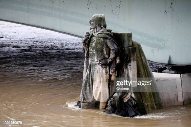 The rising Seine covers the pedestals of the Zouave statue on the Alma bridge on February 02, 2021 in Paris, France. According to Parisian tradition,...