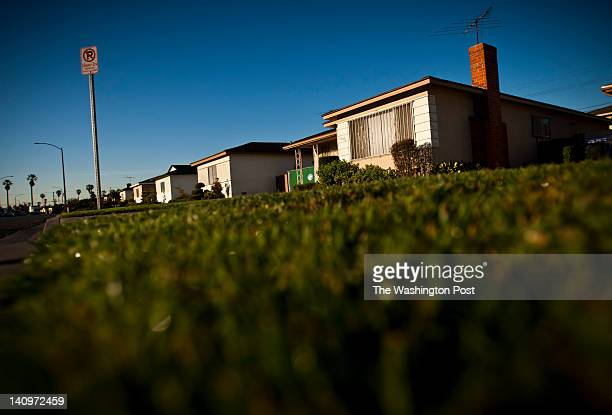The rising sun lights up a houses on the 3800 block of South Norton Avenue, February 23 in the Leimert Park neighborhood of Los Angeles, California,...