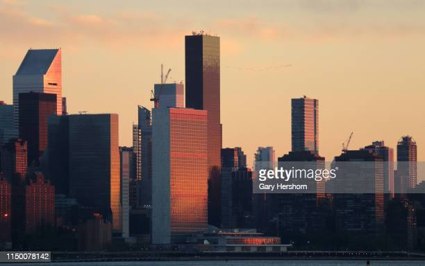 The rising sun reflects off the United Nations headquarters on May 18 2019 in New York City