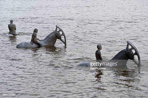 'The Rising Tide' by British underwater sculptor Jason deCaires Taylor is consumed by the waters of the River Thames at Nine Elms on the South Bank...