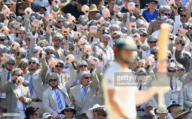 The Ritchie's watch on from the crowd as Shaun Marsh of Australia bats during day two of the Fourth Test Match in the 2017/18 Ashes series between...