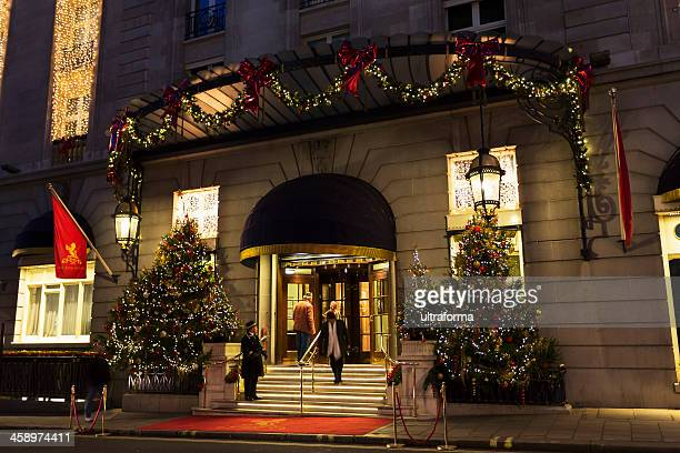 the ritz hotel piccadilly - doorman stock photos and pictures