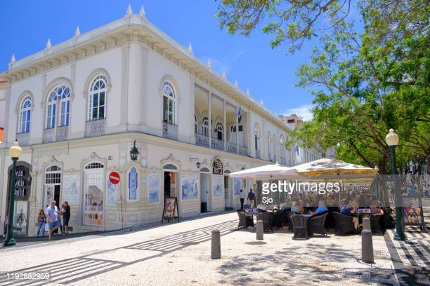 the ritz madeira cafe restaurant on the avenida arriaga in funchal madeira during a beautiful summer day - ilha da madeira imagens e fotografias de stock