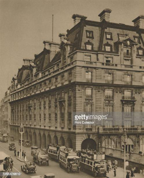 The Ritz on the Site of the Hotels of Many Generations', circa 1935. Open-topped buses outside the Ritz Hotel on Piccadilly, central London. The...