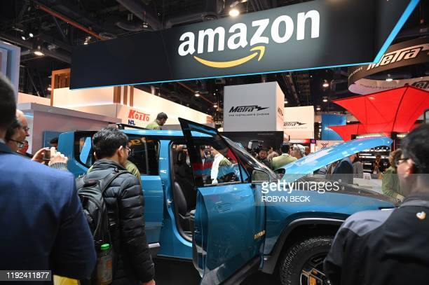 The Rivan R1T electric truck with Amazon Alexa integration is displayed at the Amazon booth January 7 2020 at the 2020 Consumer Electronics Show in...
