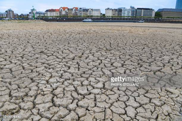 TOPSHOT The river bed of the Rhine is dried on August 8 2018 in Duesseldorf western Germany as the heatwave goes on /