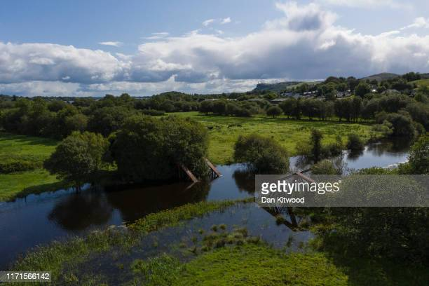 The river Belcoo which forms the border between Northern Ireland and the Republic of Ireland runs past the remains of a railway bridge blown up by...