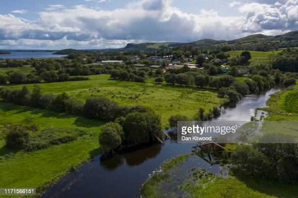 The river Belcoo which forms the border between Northern Ireland, and the Republic of Ireland runs past the remains of a railway bridge, blown up by...