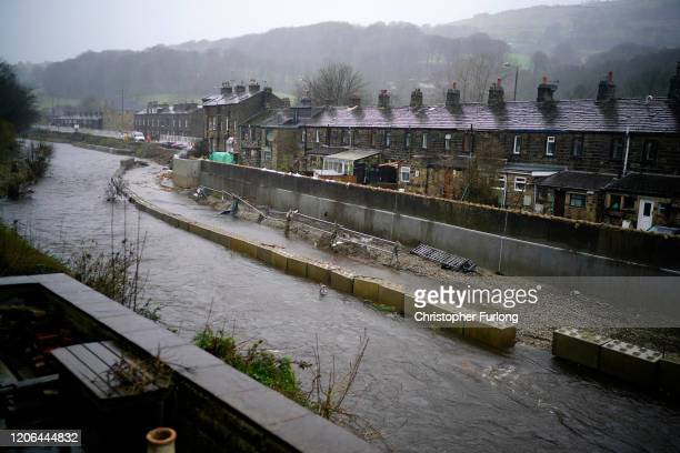 The River Calder flows through Mytholmroyd past flood defences that are under construction after previous floods on February 15 2020 in Mytholmroyd...