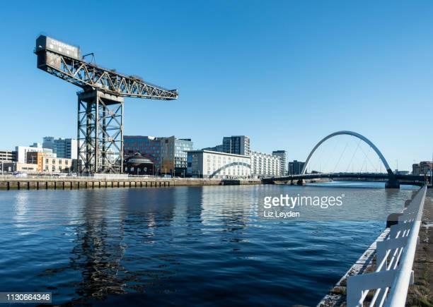 "The River Clyde in central Glasgow, with the Finnieston Crane, the Rotunda, the Radisson Hotel, the Hilton Garden Inn and Glasgow Arc (""Squinty Bridge"".."