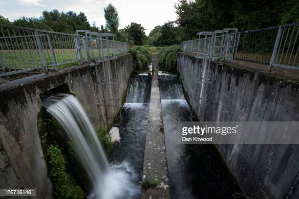 The River Cray is channeled past an industrial estate on August 17, 2020 in Bromley, England. Of the world's 224 chalk streams, 161 are in the UK....