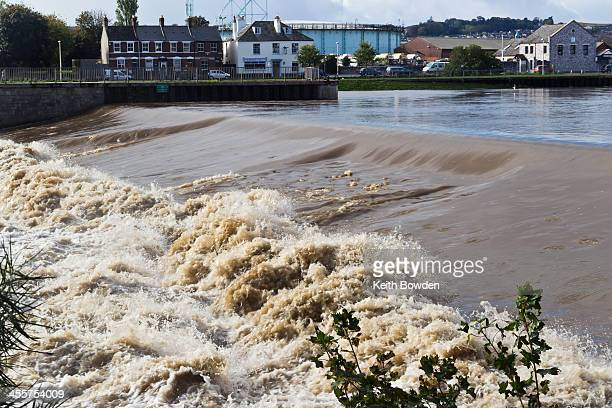 The River Exe tumbling over Trew's Weir at Exeter, Devon, in October 2013, the day after the largest storm to strike the United Kingdom so far in the...