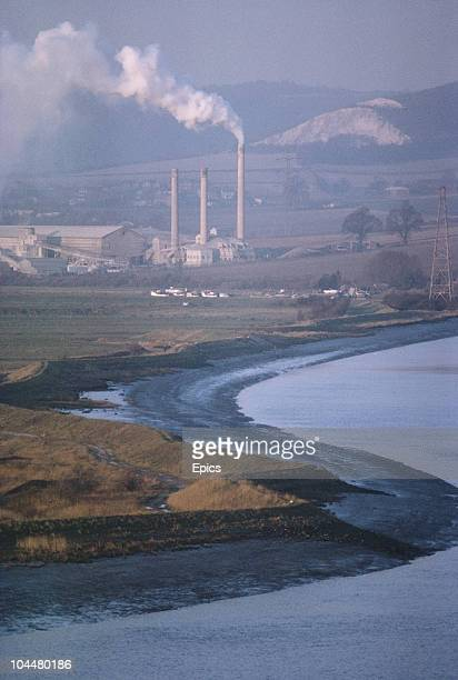 The river Medway meanders past the smoking chimneys of factories near the town of Snodland Kent April 1970