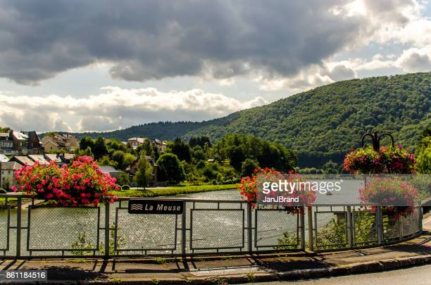the river meuse at haybes, france - meuse river stock photos and pictures